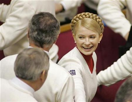 Opposition leader Yulia Tymoshenko smiles during the first parliamentary session in Kiev, November 23, 2007. REUTERS/ Gleb Garanich