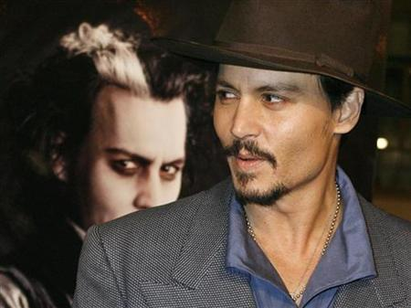 Johnny Depp poses next to a poster featuring him in character at a special screening of the DreamWorks Pictures film ''Sweeney Todd: The Demon Barber of Fleet Street'' at Paramount Studios in Hollywood, December 5, 2007. The ''Pirates of the Caribbean'' star who turns menacing in his new role as murderous barber Sweeney Todd, has been named the best celebrity autograph signer for the third year running. REUTERS/Fred Prouser