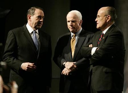 Republican Party presidential candidates gather on stage before their debate in Johnston, Iowa, December 12, 2007. The candidates are (L-R) former Arkansas Governor Mike Huckabee, U.S. Senator John McCain (R-AZ) and former New York City mayor Rudy Giuliani. REUTERS/Jason Reed