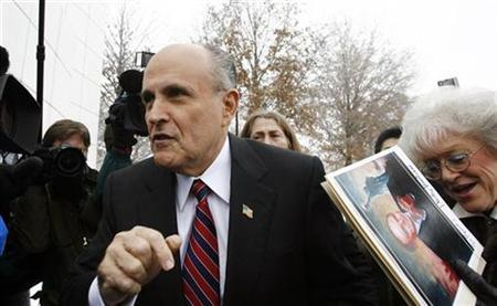 Republican Presidential candidate and former New York City Mayor Rudy Giuliani arrives for the Republican Party Debate in Johnston, Iowa, December 12, 2007. Giuliani interrupted his campaign and checked into a Missouri hospital with flu-like symptoms, according to media reports on Thursday. REUTERS/Keith Bedford