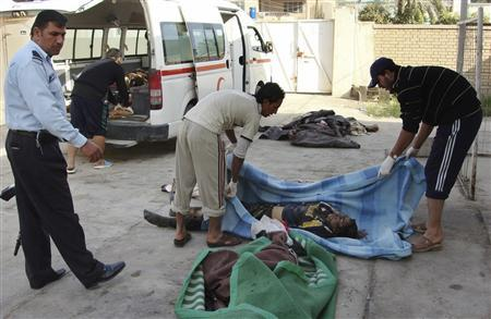 Victims of a suicide bomb attack are brought to the city morgue in Baquba, December 20, 2007. REUTERS/Stringer