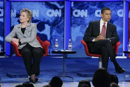 Senator Hillary Clinton (D-NY) and Senator Barack Obama (D-IL) sit onstage during the CNN/Nevada Democratic Party debate at the University of Nevada Las Vegas (UNLV) in Las Vegas, Nevada November 15, 2007. REUTERS/Steve Marcus