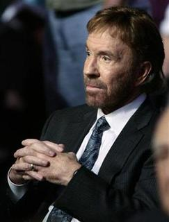 File photo showa actor Chuck Norris in St. Petersburg, Florida, November 28, 2007. Norris sued publisher Penguin on Friday over a book he claims unfairly exploits his famous name, based on a satirical Internet list of ''mythical facts'' about him. REUTERS/Scott Audette