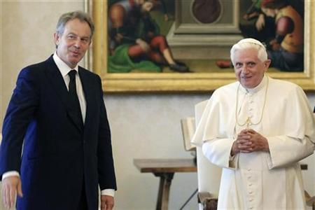 Pope Benedict XVI poses with Tony Blair (L) during their private meeting at the Vatican June 23, 2007. Blair, now the Middle East peace envoy, has converted from Anglicanism to Roman Catholicism, the head of Britain's Catholics said on Saturday. REUTERS/Osservatore Romano