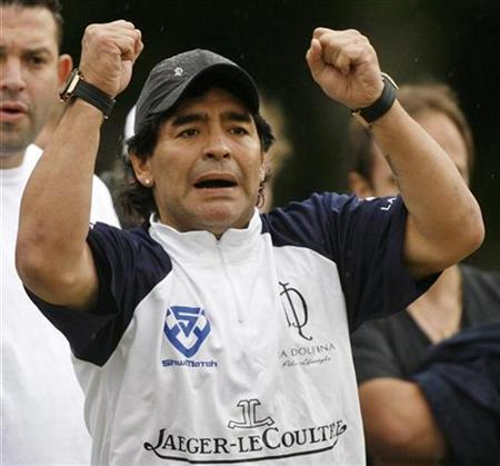 In this file photo Argentine soccer great Diego Maradona cheers for La Dolfina polo team during their final game against Ellerstina in the Argentine Open Polo Championship at the Campo Argentino de Polo in the Buenos Aires' neighborhood of Palermo December 8, 2007. Maradona says he wants to meet Iranian President Mahmoud Ahmadinejad, a leading U.S. foe, local media reported on Monday. REUTERS/Enrique Marcarian