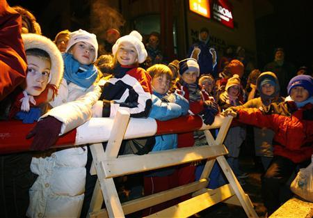 Children hang over the gate at the border between Slovenia and Italy at Robic December 21, 2007. Slovenia's clean and prosperous countryside, becoming attractive to tourists, looks more like Switzerland than communist Yugoslavia, which it quit in 1991 after a brief war with the Serb-dominated federal army. REUTERS/Srdjan Zivulovic