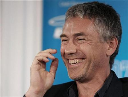 Director Tony Gilroy laughs during the news conference for ''Michael Clayton'' at the 32nd Toronto International Film Festival in Toronto, September 8, 2007. On the surface, the behind-the-scenes intrigues of a corporate law firm hardly seem cinematic enough to justify a screenplay. But when ''Michael Clayton'' writer-director Gilroy started digging around while researching 1997's ''The Devil's Advocate,'' he was hooked. REUTERS/ Mike Cassese