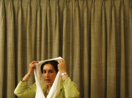 Opposition leader Benazir Bhutto adjusts her head scarf during a news conference at her residence in Karachi in this November 21, 2007 file photo. REUTERS/Adrees Latif/Files