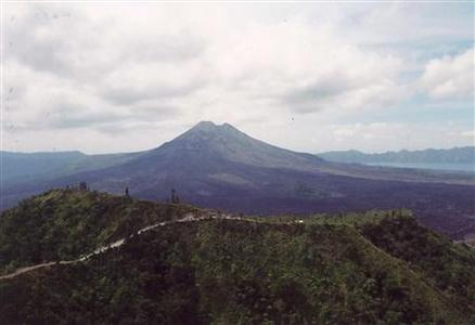Volcano trekking is seen in Bali, Indonesia in this undated handout photo. REUTERS/Handout/IgoUgo