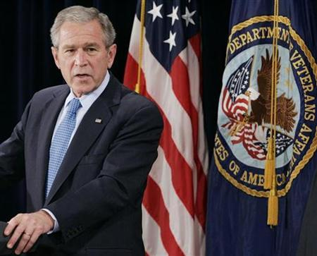 President George W. Bush speaks while at the Department of Veterans Affairs in Washington December 20, 2007. Bush on Saturday signed into law a temporary extension of a popular health insurance program for children after months of deadlock with the Democratic-led Congress. REUTERS/Larry Downing