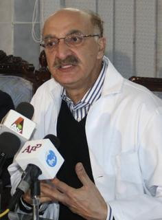 Mussadiq Khan, a doctor from Rawalpindi General Hospital, speaks during a news conference in Rawalpindi December 28, 2007. A grim twist of fate saw Khan struggling to save the life of a Pakistani leader struck down by an assassin just as his father had done 56 year ago. REUTERS/Stringer