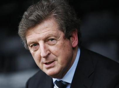 Fulham Football Club's new manager Roy Hodgson poses for photographers before a news conference at their training ground in Surrey following his appointment as permanent manager December 31, 2007. Hodgson said on Monday he felt no pressure to prove himself to the club's fans or English football as a whole as he prepared for a daunting first game in charge against Chelsea on Tuesday. REUTERS/Stephen Hird