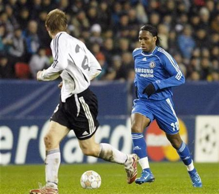In this file photo Chelseas Didier Drogba (R) controls the ball during their Champions League Group B football match against Rosenborg at Lerkendal Stadium in Trondheim November 28, 2007. The African Nations Cup is taking place in tropical Ghana but the impact of the tournament will felt in the cooler climes of Britain as a host of big name Premier League players head off to the sun. REUTERS/Thomas R. Skaug/Scanpix Norway