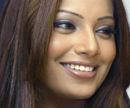 Bollywood actress Bipasha Basu is seen in New Delhi in this March 5, 2003 file photo. Basu's maiden Bengali film will see her trade in her glitzy outfits for saris in Rituparno Ghosh's ''Sob Choritro Kalponik''.REUTERS/Kamal Kishore/Files