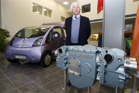 Guy Negre, head of French company MDI enterprises s.a, poses with a motor which runs entirely on compressed air, producing zero emissions, in Carros, south eastern France, January 4, 2008. REUTERS/Eric Gaillard