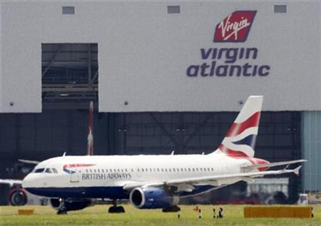 A British Airways aeroplane is seen through a heat haze in front of a Virgin Atlantic hanger at London's Heathrow airport, August 1, 2007. Virgin Atlantic cabin crew who are members of the Unite union called off plans to strike at the eleventh hour on Monday after they agreed to new pay conditions, the union and airline said. REUTERS/Stephen Hird