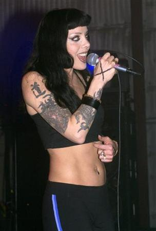 Bif Naked performs for guests at a party March 16, 2000 at Paramount Studios in Hollywood. Naked has gone public after being diagnosed with breast cancer, saying she is facing the fight of her life and urging other women to ensure they regularly check for cancer. REUTERS/Rose Prouser