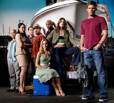 The cast of ''Dexter'' in an undated image courtesy of Showtime. CBS, seeking to fill programming holes left by the writers' strike, said on Monday it will rerun the entire first season of the crime drama ''Dexter'' from Showtime, its sister cable channel, starting next month. REUTERS/Handout