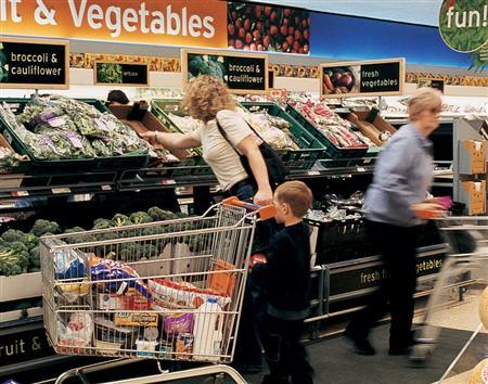 A grocery store produce section in a file image. People who drink moderately, exercise, quit smoking and eat five servings of fruit and vegetables each day live on average 14 years longer than people who adopt none of these behaviors, researchers said on Tuesday. REUTERS/File