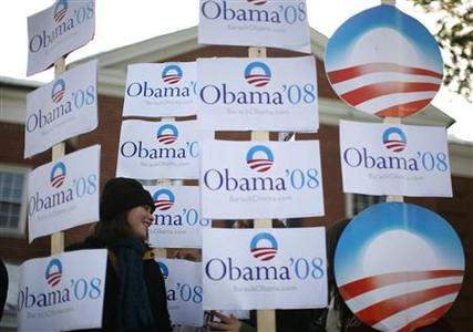 A supporter of Democratic presidential candidate Senator Barack Obama (D-IL) greets voters outside a polling station in Manchester, New Hampshire, January 8, 2008. REUTERS/Jim Young