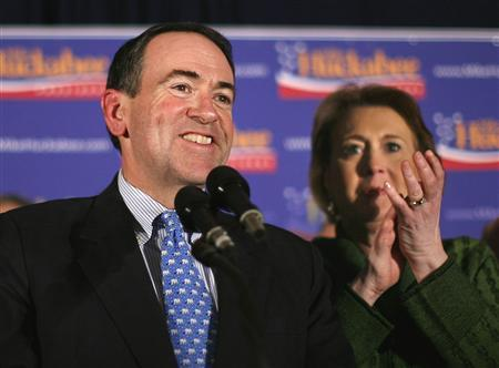 Republican presidential candidate Mike Huckabee speaks to supporters as his wife Janet shares the stage at his New Hampshire primary night rally in Manchester January 8, 2008. REUTERS/Carlos Barria