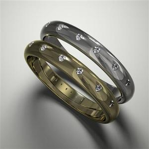 A pair of diamond-set wedding rings from Cred Jewellery are seen in this undated handout photo. Analysts say global sales of ethical gold jewellery are probably less than one percent of the total $56 billion gold jewellery market based on figures from London-based consultancy GFMS -- and the Fairtrade label is a year or so away. REUTERS/Handout.
