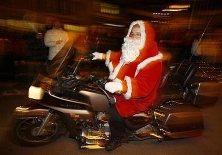 A man dressed as Santa Claus rides on a motorbike through the village of Kuessnacht am Rigi on the shores of Lake Lucerne before the traditional ''Klausjagen'' procession in Switzerland in this December 5, 2007 file photo. A groping Santa, a drunken car chase, a bloody punchout. Festivities in Antarctica got a little out of hand this Christmas. REUTERS/Arnd Wiegmann