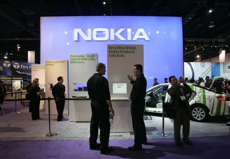 Show attendees talk in front of the Nokia booth during the Consumer Electronics Show (CES) in Las Vegas, January 8, 2008. REUTERS/Steve Marcus