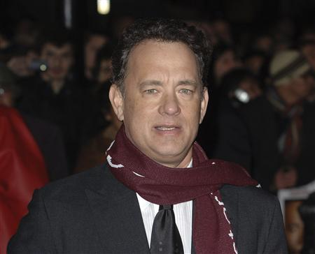 Tom Hanks poses for photographers at the premiere of ''Charlie Wilson's War'' in London, January 9, 2008. REUTERS/Anthony Harvey