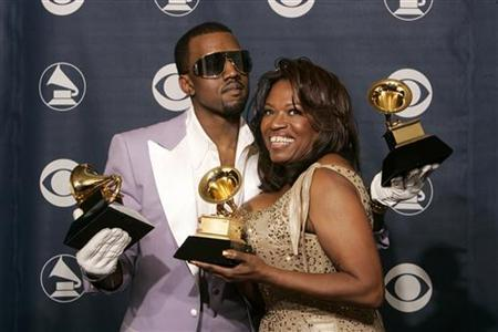 Rap singer Kanye West (L) poses with his mother Donda West at the 48th annual Grammy Awards in Los Angeles February 8, 2006. The Los Angeles County Coroner said on Thursday the exact cause of Donda West's death in November was unclear but there was no sign of ''surgical or anesthetic misadventure.'' REUTERS/Robert Galbraith