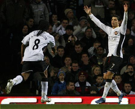 Manchester United's Cristiano Ronaldo (R) celebrates his goal against Aston Villa with Anderson during their FA Cup third round match at Villa Park on January 5, 2008. Manchester United Plc said its annual pre-tax profit doubled on increased sponsorship and after it expanded its stadium and won the League title. REUTERS/Darren Staples