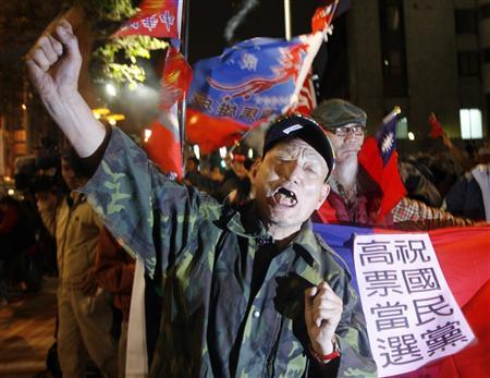 Supporters of Taiwan's main opposition Nationalist Party (KMT) celebrate after the Taiwan legislative elections outside the party's headquarters in Taipei January 12, 2008. REUTERS/Nicky Loh