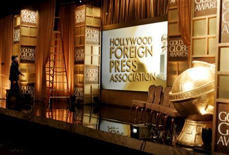 A crew member works on stage in front of the set for the 65th annual Golden Globe Awards news conference at the Beverly Hilton hotel in Beverly Hills, January 13, 2008. REUTERS/Fred Prouser