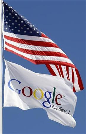 A U.S. flag flies above Google office in Santa Monica, California, October 3, 2007. Communications regulators have cleared Google Inc <GOOG.O> to bid in an upcoming auction of coveted wireless airwaves, according to auction documents released by the Federal Communications Commission on Monday. REUTERS/Lucy Nicholson