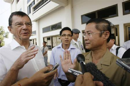 Co-investigating judges of the ''Killing Fields'' tribunal, You Bunleng (R) and French Marcel Lemonde (L) talk to the media before their first meeting with former lower ranking of Khmer Rouge rebels at Pailin city hall in the northwestern province of Pailin January 15, 2008. REUTERS/Chor Sokunthea