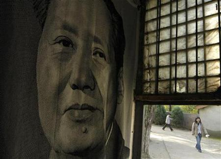 A portrait of Chinese leader Mao Zedong is seen inside a shop in Yan'an, northwest China's Shaanxi province October 15, 2007. French car-maker Citroen has apologized to China for running a full-page advertisement in several Spanish newspapers featuring a poster of Mao pulling a wry face at a sporty hatch-back. REUTERS/Stringer