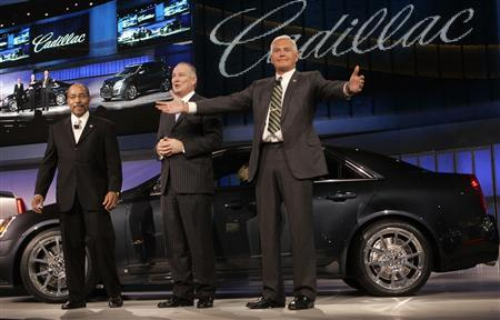 General Motors Vice President of Global Design Ed Welburn (L) and General Manager Jim Taylor (C) listen as Vice Chairman Bob Lutz invites the audience on to the stage for a closer look at the vehicles during press days of the 2008 North American International Auto Show in Detroit, Michigan, January 14, 2008. REUTERS/Rebecca Cook