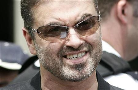 George Michael reads a statement to the media as he leaves Brent Magistrates Court in London June 8, 2007. Michael will write a no-holds-barred biography to appear in autumn 2009 after signing what HarperCollins called ''one of the biggest book deals ever concluded in UK publishing.'' REUTERS/James Boardman