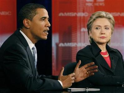 Senator Barack Obama makes a point as Senator Hillary Clinton listens during the MSNBC/Nevada Democratic Party presidential candidates' debate in Las Vegas, January 15, 2008. REUTERS/Rick Wilking