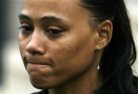 Former Olympic medalist Marion Jones speaks to reporters after her sentencing at the U.S. Federal Courthouse in White Plains, New York, January 11, 2008. REUTERS/Jeff Zelevansky