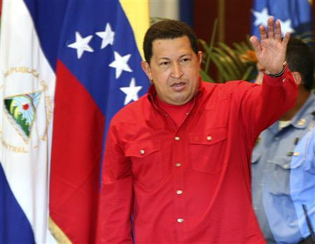Venezuela's President Hugo Chavez gestures upon arriving for a meeting with producers and businessmen, in Managua, January 16, 2008. REUTERS/Oswaldo Rivas