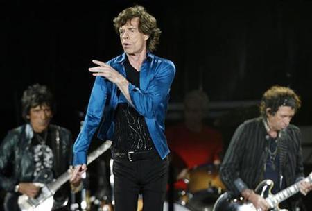 Rolling Stones lead singer Mick Jagger (C), guitarist Keith Richards (R), drummer Charlie Watt (2nd R) and Ron Wood (L) perform during the band's ''A Bigger Bang'' European tour stop in Lausanne August 11, 2007. The Rolling Stones has signed an exclusive worldwide recording agreement to release its next album through Universal Music Group, prompting speculation that it could leave EMI. REUTERS/Denis Balibouse