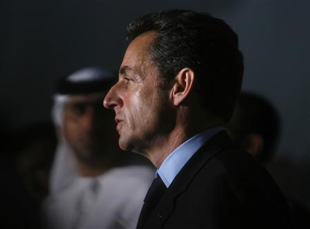 France's President Nicolas Sarkozy listens to the French national anthem after his speech to the French community, at the Emirates Palace Hotel in Abu Dhabi January 15, 2008. REUTERS/Ahmed Jadallah