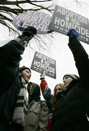 Pro-choice activist Luqman Clark (L), of Arlington, VA, argues with a group of anti-abortion protestors outside the U.S. Supreme Court in Washington January 24, 2005, during the 32nd annual March For Life protest against the Supreme Court's decision in the Roe v. Wade abortion rights decision. REUTERS/Jason Reed