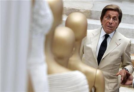 Veteran Italian fashion designer Valentino Garavani poses during the opening of his exhibition at the Ara Pacis Museum in Rome July 6, 2007. The life of fashion designer Valentino is coming to the big screen in the documentary ''Valentino: The Last Emperor.'' REUTERS/Alessandro Bianchi