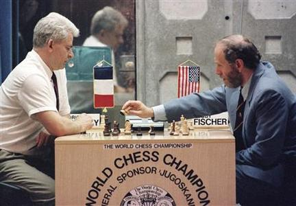 Former world chess champion Bobby Fischer (R) moves a piece during a September 1992 match against his archrival, the Soviet Union's Boris Spassky, in the Yugoslav resort of Sveti Stefan. Fischer has died of a serious but unspecified illness, Iceland national radio reported on Friday. REUTERS/Ivan Milutinovic/Files