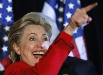 Democratic presidential candidate Sen. Hillary Clinton points to supporters before she gives a victory speech after winning the Democratic caucuses in Las Vegas January 19, 2008. REUTERS/Rick Wilking