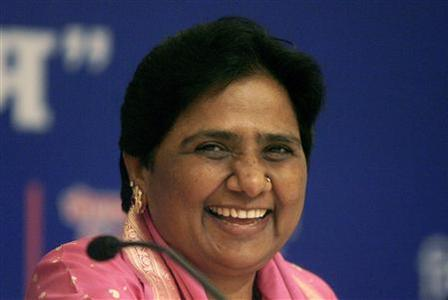 Chief Minister of the northern Indian state of Uttar Pradesh Mayawati smiles after her birthday celebrations in New Delhi in this January 15, 2008 file photo. For a leader dubbed the ''Untouchables Queen'' who runs one of India's poorest states, it was indeed a birthday bash fit for royalty. Dressed in a diamond necklace and matching earrings Mayawati stood as her mostly higher-caste party aides and the state police chief each scooped up slops of her 52nd birthday cake in their hands and finger-fed their boss. REUTERS/Tanushree Punwani/Files