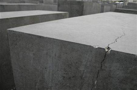 A crack of one of the concretes of the ''Holocaust Mahnmahl'' memorial is pictured in Berlin August 8, 2007. The Holocaust memorial is showing signs of serious wear and tear just three years after its completion, with cracks in more than half of its concrete blocks, according to a study published on Monday. REUTERS/Tobias Schwarz