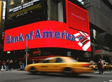 A taxi speeds past a Bank of America branch in New York's Times Square January 11, 2008. Bank of America Corp, the second-largest U.S. bank, on Tuesday said fourth-quarter profit fell, hurt by mounting credit losses and weak investment banking results. REUTERS/Brendan McDermid
